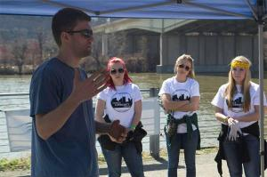 Photo by Tyrone Smith Jeff McCauley, stewardship coordinator of Friends of the Riverfront, speaks to students April 12 about the task they will be completing as a part of their volunteer work for Pioneer Community Day.