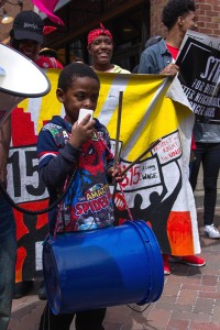 Photo by Liz Berie Minimum wage mascot Ahmarée Osborne shows his support by chanting out songs at Market Square on Wednesday, April 15.